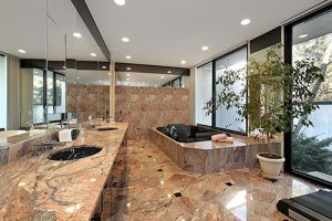 mystique beauty in black incased in a tan marbled bathroom