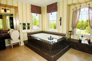 Rachael Beauty white tub incased in dark black and orange granite