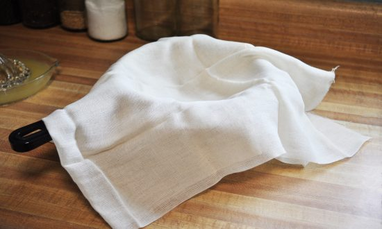 cheese cloth over a pot
