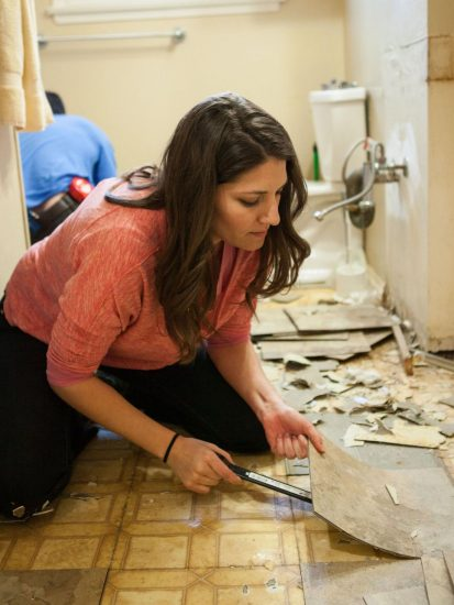 brunette women in the process of renovating a bathroom
