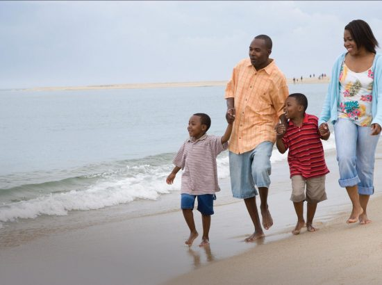 a happy african american family at the beach