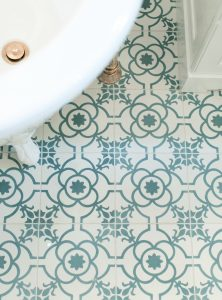 suzy kloner design tile with a teach and white decorative tile
