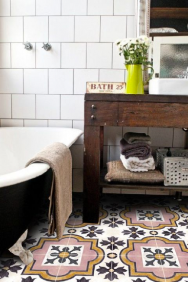 decorative tiled bathroom floor with dark wood rack black bathtub with white interior and white tiled walls