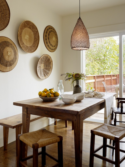 Wood table in a dining room with white walls and two chairs