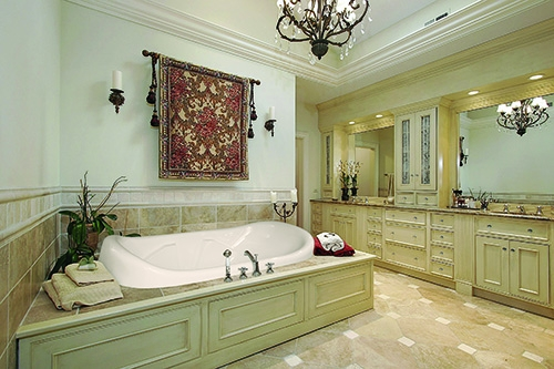 natalie beauty tub in a green and cream bathroom
