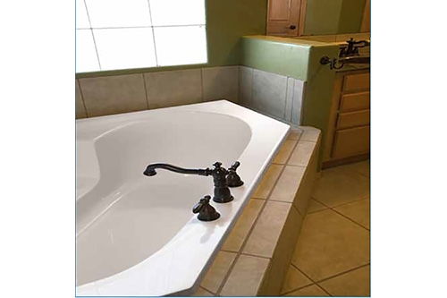 Rincon Beauty tub incased in large beige tile