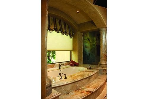 Savannah Beauty tub incased in beige/gold marble