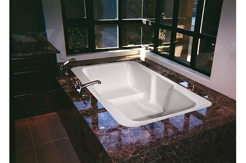 victoria beauty tub incased in dark marble