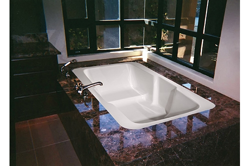 victoria beauty tub incased in dark marble